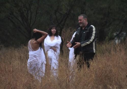 U.S. artist Spencer Tunick talks to naked volunteers in San Miguel de Allende